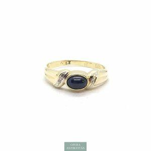 Arany gyűrű gyémántokkal és kék zafírral.